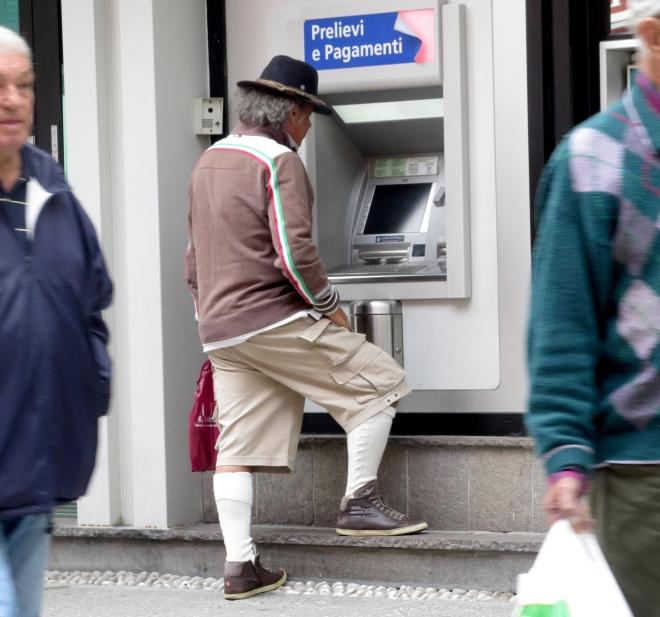 man with hat bank machine San Candido 815.JPG