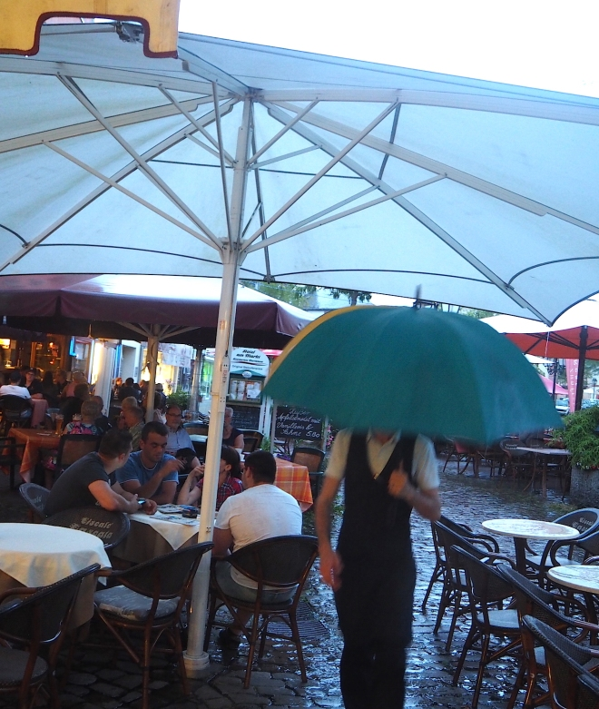 waiter umbrella rain Saarburg 716.JPG