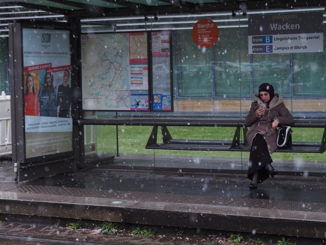 woman tram stop phone Strasbourg 118.JPG
