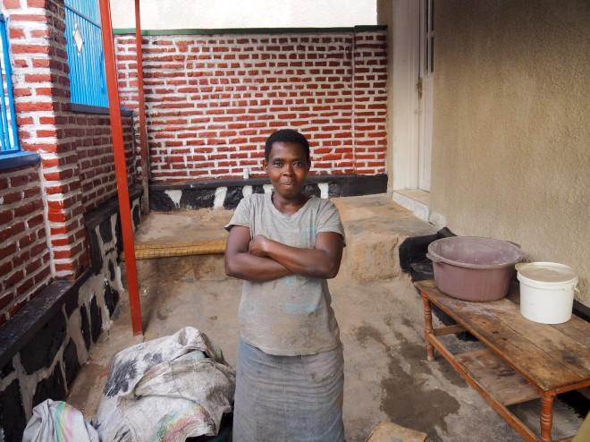 street Kigali 419 Cyahafi girl outside shop.JPG