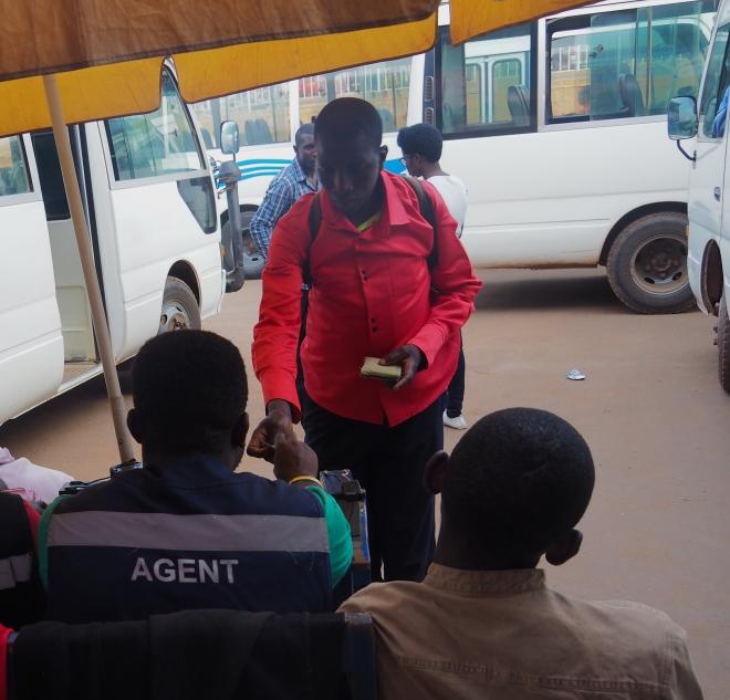 street Nyabugogo Kigali 419 bus station bus ticket buying PhD.JPG