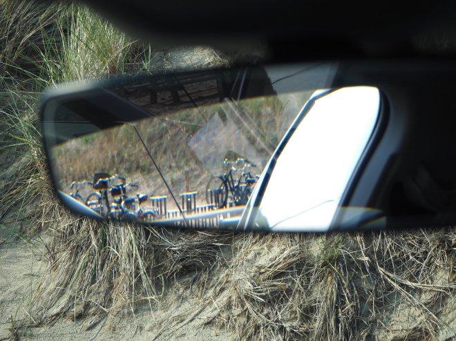bike racks in car rear view mirror dune beach Sint Martenzee 619.JPG