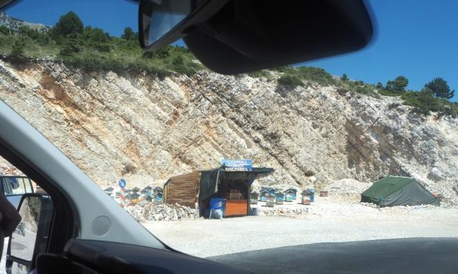 limestone beehives honey shop tent minivan Vlorë-Sarandë 819.JPG