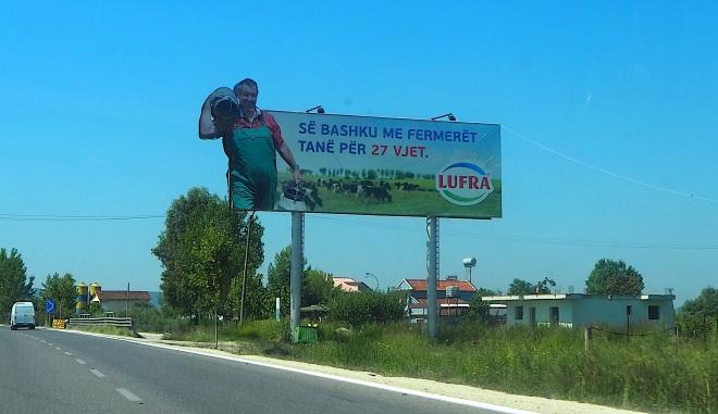 public milk churn farmer cows advert taxi Durrës-Vlorë 819.JPG