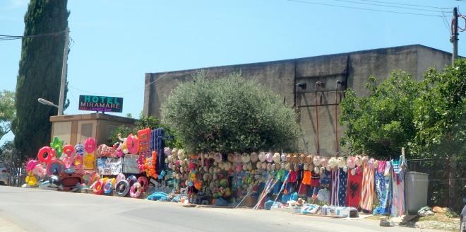roadside beach equpment rings towels hats minivan Vlorë-Sarandë 819.JPG
